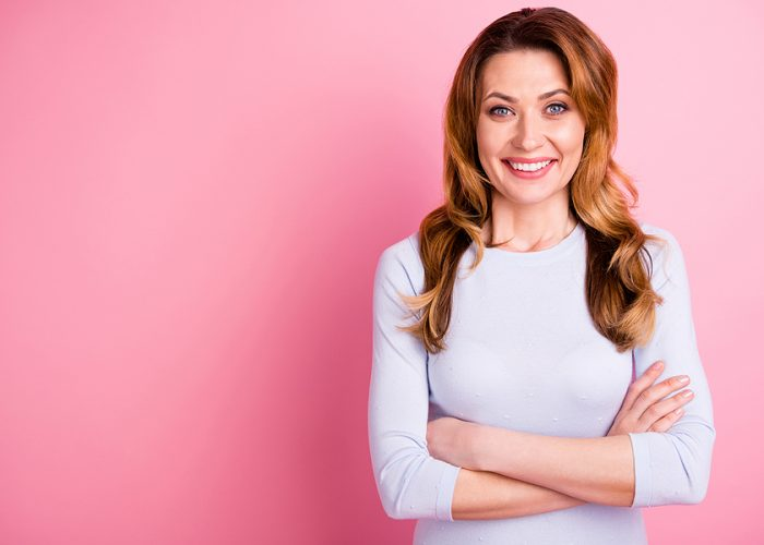 Portrait of positive cheerful woman true executive ready to solve work questions feel glad wear white pullover isolated over pastel color background